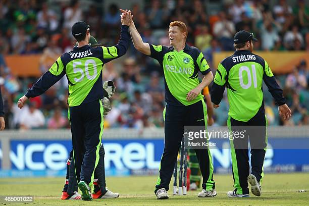 George Dockrell of Ireland congratulates Kevin O'Brien of Ireland as he celebrates taking the wicket of Faf du Plessis of South Africa during the...