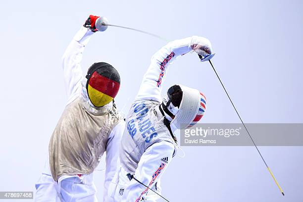 George Doerr of Germany and Alex Tofalides of Great Britain compete in the Men's Team Foil quarter finals during day fifteen of the Baku 2015...