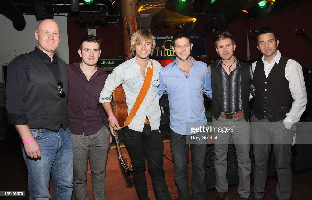 George Donaldson, Emmet Cahill, Keith Harkin, Colm Keegan, Neil Byrne and Ryan Kelly of Celtic Thunder pose for pictures prior to their unplugged concert benefitting Hurricane Sandy victims at Sullivan Hall on December 3, 2012 in New York City.