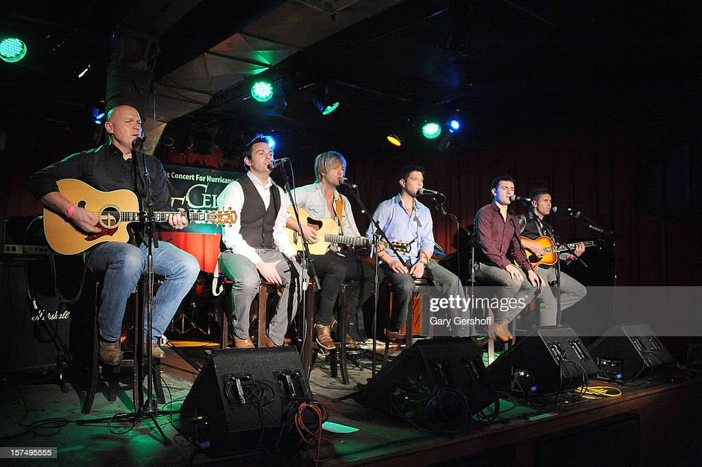 George Donaldson, Ryan Kelly, Keith Harkin, Colm Keegan, Emmet Cahill and Neil Byrne of Celtic Thunder perform an unplugged concert benefitting Hurricane Sandy victims at Sullivan Hall on December 3, 2012 in New York City.