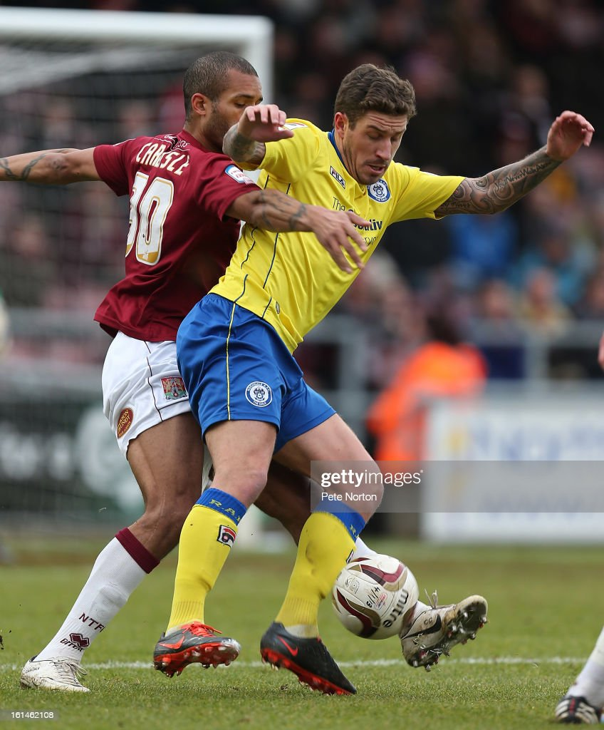George Donnelly of Rochdale attempts to control the ball under pressure from <a gi-track='captionPersonalityLinkClicked' href=/galleries/search?phrase=Clarke+Carlisle&family=editorial&specificpeople=204318 ng-click='$event.stopPropagation()'>Clarke Carlisle</a> of Northampton Town during the npower League Two match between Northampton Town and Rochdale at Sixfields Stadium on February 9, 2013 in Northampton, England.