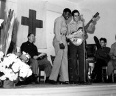 George E Bolden and Tony Milicia sing Spanish songs at the opening of an American Red Cross Club Sydney Australia 1945
