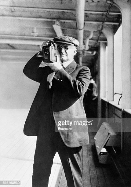 George Eastman taking pictures with a Kodak camera