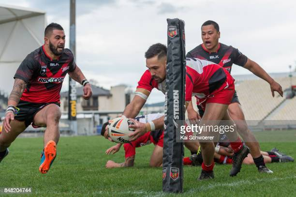 George Edwards of Counties Manukau dives over to score a try during the NZ Rugby League Premiership round one match between the Canterbury Bulls and...