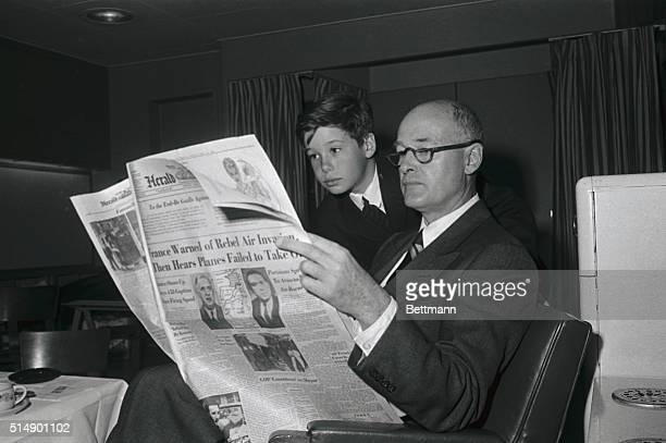 George F Kennan newly appointed US Ambassador to Yugoslavia and his son Christopher reading about the French situation on board the SS Constitution