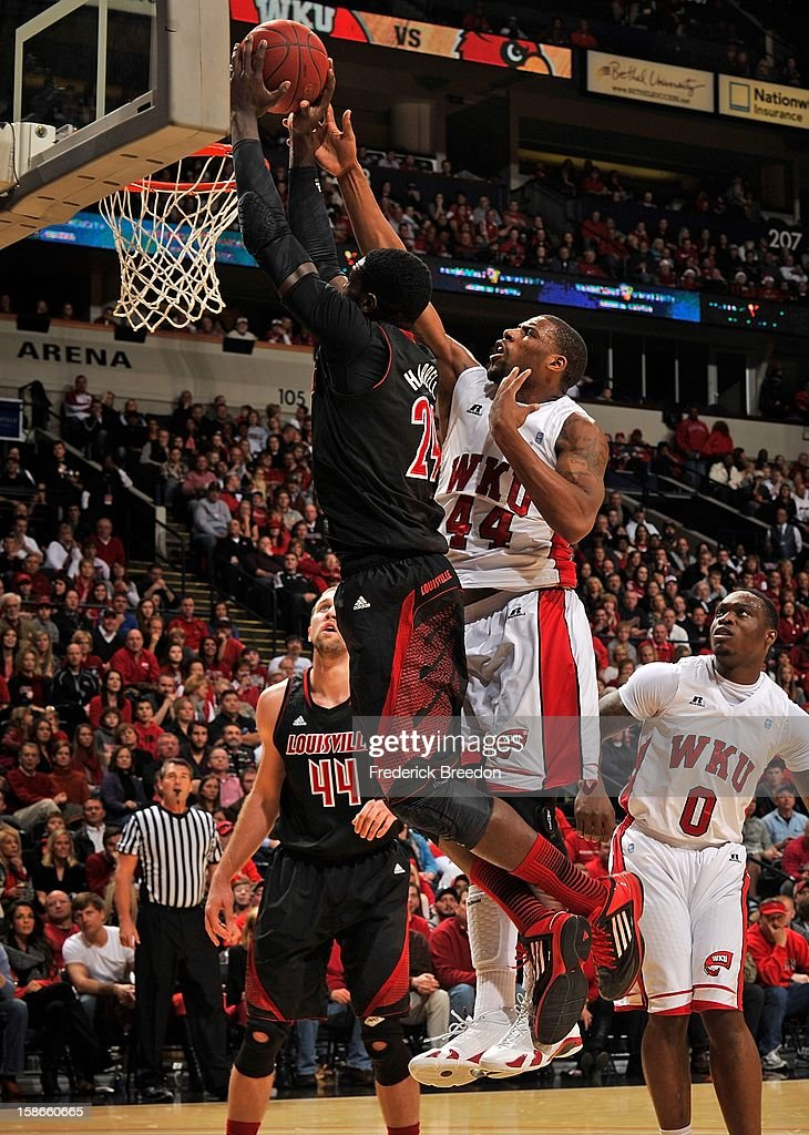 George Fant #44 of the Western Kentucky Hilltoppers tries to block the shot of Montrezl Harrell #24 of the Louisville Cardinals at Bridgestone Arena on December 22, 2012 in Nashville, Tennessee.