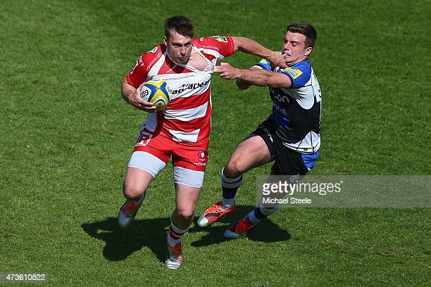 George Ford of Bath challenges Brendan Macken of Gloucester during the Aviva Premiership match between Bath Rugby and Gloucester Rugby at the...