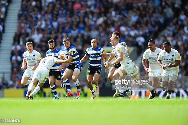 George Ford of Bath is tackled by Richard Wigglesworth of Saracens during the Aviva Premiership Final between Bath Rugby and Saracens at Twickenham...