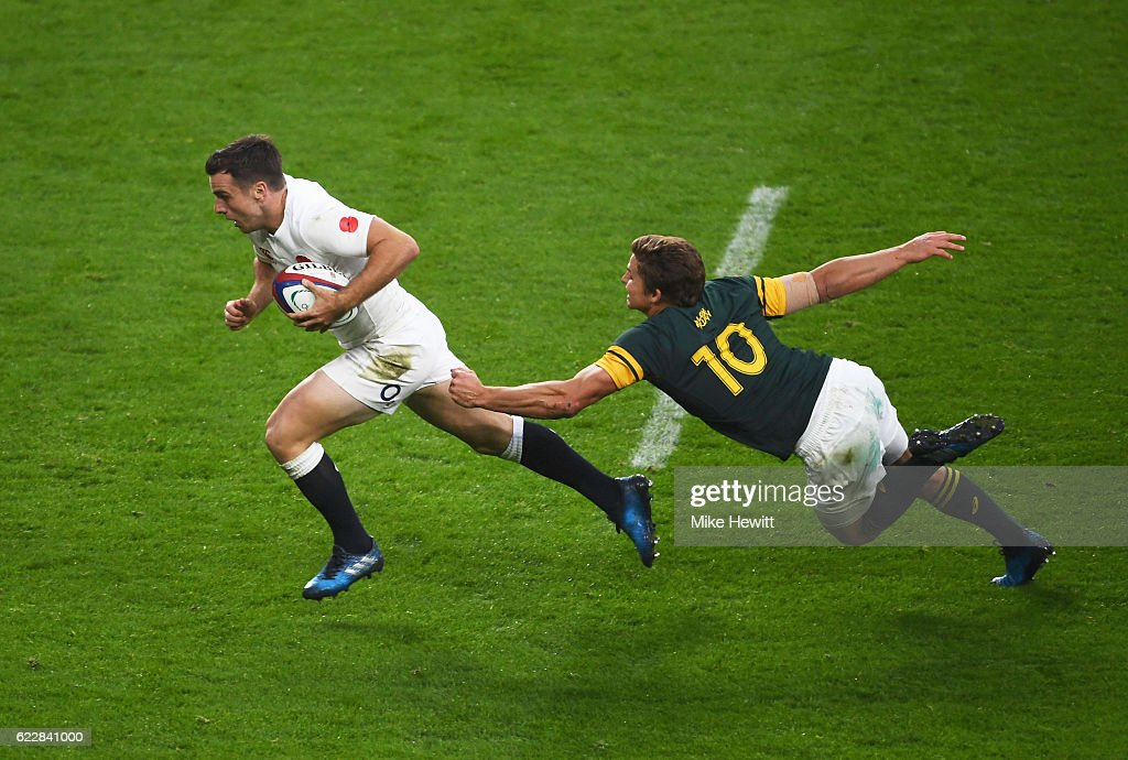 George Ford of England goes past a tackle by Pat Lambie of South Africa to score his team's third try during the Old Mutual Wealth Series match between England and South Africa at Twickenham Stadium on November 12, 2016 in London, England.