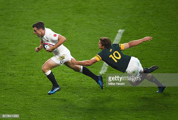 George Ford of England goes past a tackle by Pat Lambie of South Africa to score his team's third try during the Old Mutual Wealth Series match...