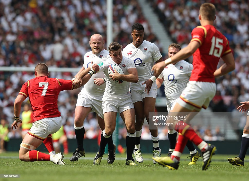 <a gi-track='captionPersonalityLinkClicked' href=/galleries/search?phrase=George+Ford+-+Rugby-Union-Spieler&family=editorial&specificpeople=11374128 ng-click='$event.stopPropagation()'>George Ford</a> of England is tackled by <a gi-track='captionPersonalityLinkClicked' href=/galleries/search?phrase=Dan+Lydiate&family=editorial&specificpeople=4598857 ng-click='$event.stopPropagation()'>Dan Lydiate</a> during the England v Wales International match at Twickenham Stadium on May 29, 2016 in London, England.