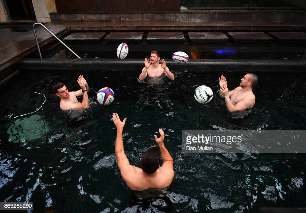 George Ford Owen Farrell Ben Youngs and Mike Brown of England complete a passing drill during a recovery session at the Hilton Vilamoura on November...
