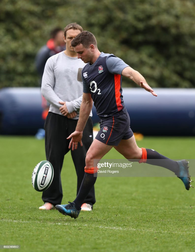 George Ford practices his kicking as Jonny Wilkinson, the kicking coach looks on during the England training session held at Pennyhill Park on March 14, 2017 in Bagshot, England.
