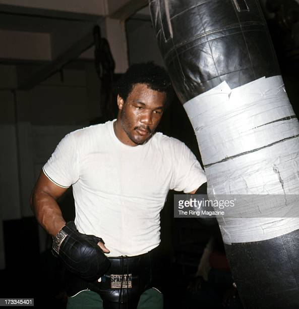 George Foreman hits the punching bag as he trains in a Los Angeles gym