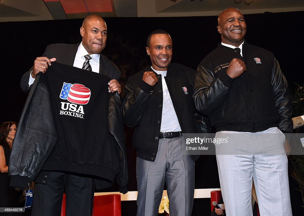 George Foreman Jr., representing his father, and former boxers <a gi-track='captionPersonalityLinkClicked' href=/galleries/search?phrase=Sugar+Ray+Leonard&family=editorial&specificpeople=206479 ng-click='$event.stopPropagation()'>Sugar Ray Leonard</a> and <a gi-track='captionPersonalityLinkClicked' href=/galleries/search?phrase=Evander+Holyfield&family=editorial&specificpeople=194938 ng-click='$event.stopPropagation()'>Evander Holyfield</a> pose wearing jackets they were presented for being former United States Olympians at the second annual Nevada Boxing Hall of Fame induction gala at the New Tropicana Las Vegas on August 9, 2014 in Las Vegas, Nevada.