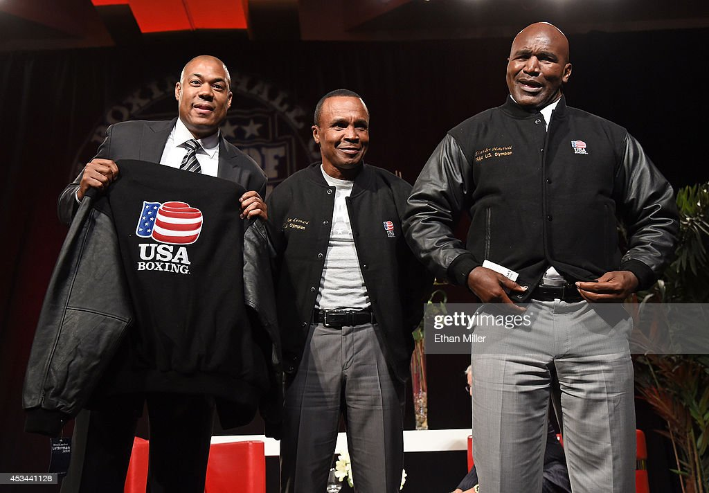 George Foreman Jr., representing his father, and former boxers Sugar Ray Leonard and Evander Holyfield pose wearing jackets they were presented for being former United States Olympians at the second annual Nevada Boxing Hall of Fame induction gala at the New Tropicana Las Vegas on August 9, 2014 in Las Vegas, Nevada.