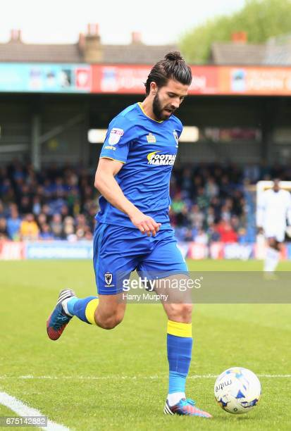 George Francomb of AFC Wimbledon runs with the ball during the Sky Bet League One match between AFC Wimbledon and Oldham Athletic at The Cherry Red...