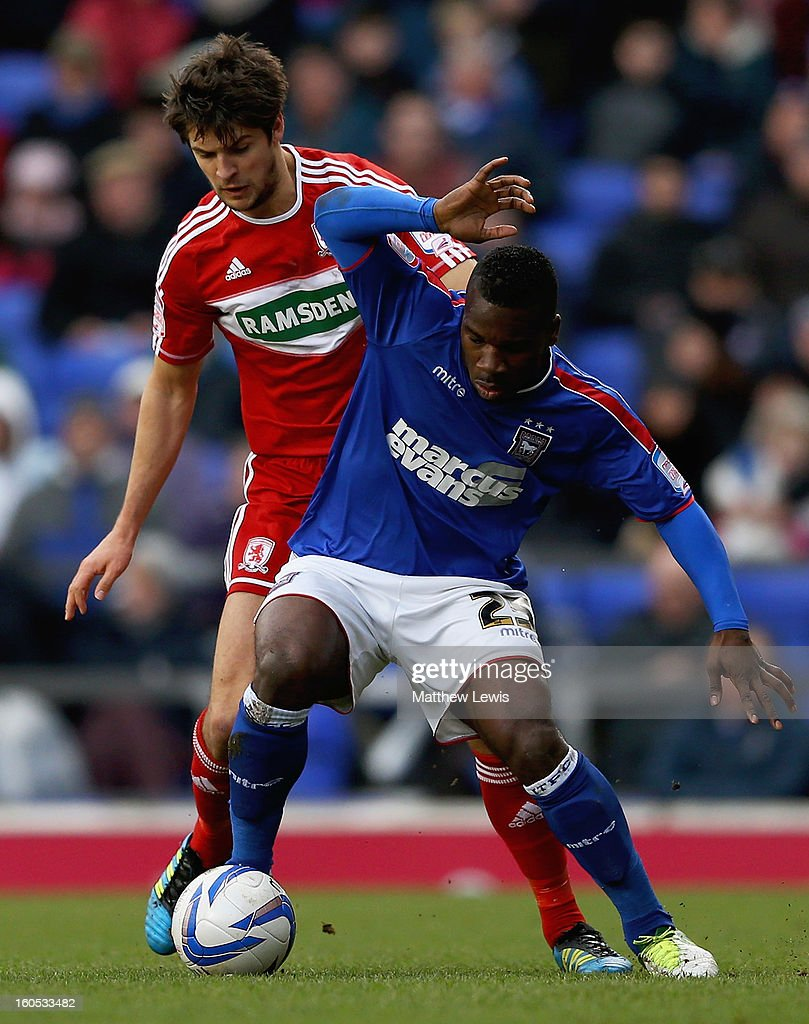 George Friend of Middlesbrough and Aaron McLean of Ipswich challenge for the ball during the npower Championship match between Ipswich Town and Middlesbrough at Portman Road on February 2, 2013 in Ipswich, England.