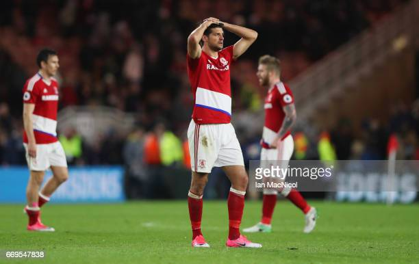 George Friend of Middlesbrough and team mates look dejected in defeat after during the Premier League match between Middlesbrough and Arsenal at...