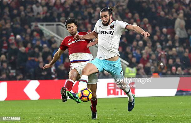 George Friend of Middlesbrough attempts to tackle Andy Carroll of West Ham United during the Premier League match between Middlesbrough and West Ham...