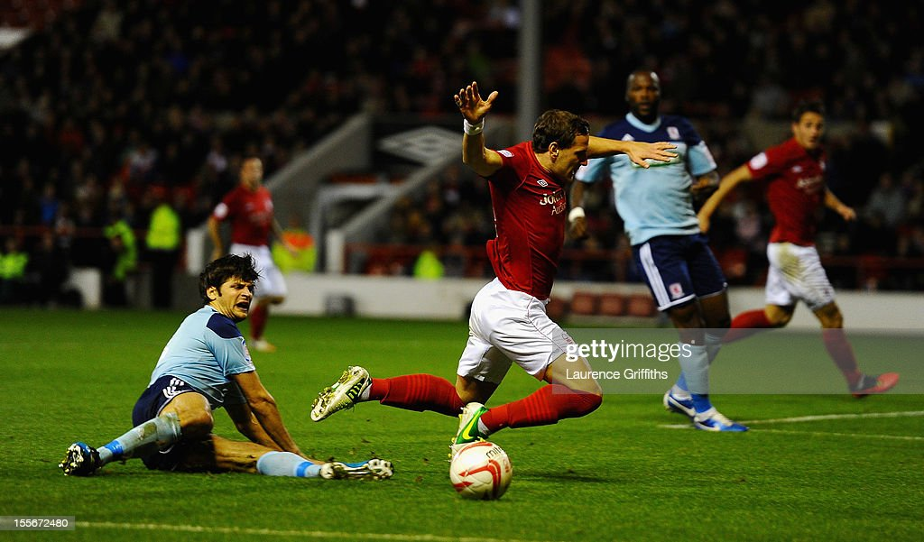 George Friend of Middlesbrough battles with Billy Sharp of Nottingham Forest during the npower Championship match between Nottingham Forest and Middlesbrough at the City Ground on November 6, 2012 in Nottingham, England.