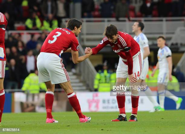 George Friend of Middlesbrough celebrates Marten De Roon scoring the only goal during the Premier League match between Middlesbrough FC and...