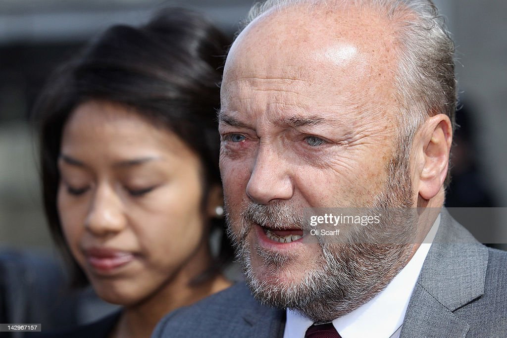 George Galloway (R) answers journalist's questions with his wife Putri Gayatri Pertiwi (L) in front of the Houses of Parliament prior to being sworn in as a member of parliament on April 16, 2012 in London, England. Last month Mr Galloway won the Bradford West by-election with a majority of over 10,000 votes from Labour. The shock victory saw a swing towards his Respect party of over 36% from their fifth-place position in the 2010 general election.