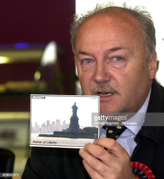 George Galloway MP Galloway holding a 'Respect' party post card showing a mockup picture of of a torture victim in Iraq on the Statue of Liberty as...