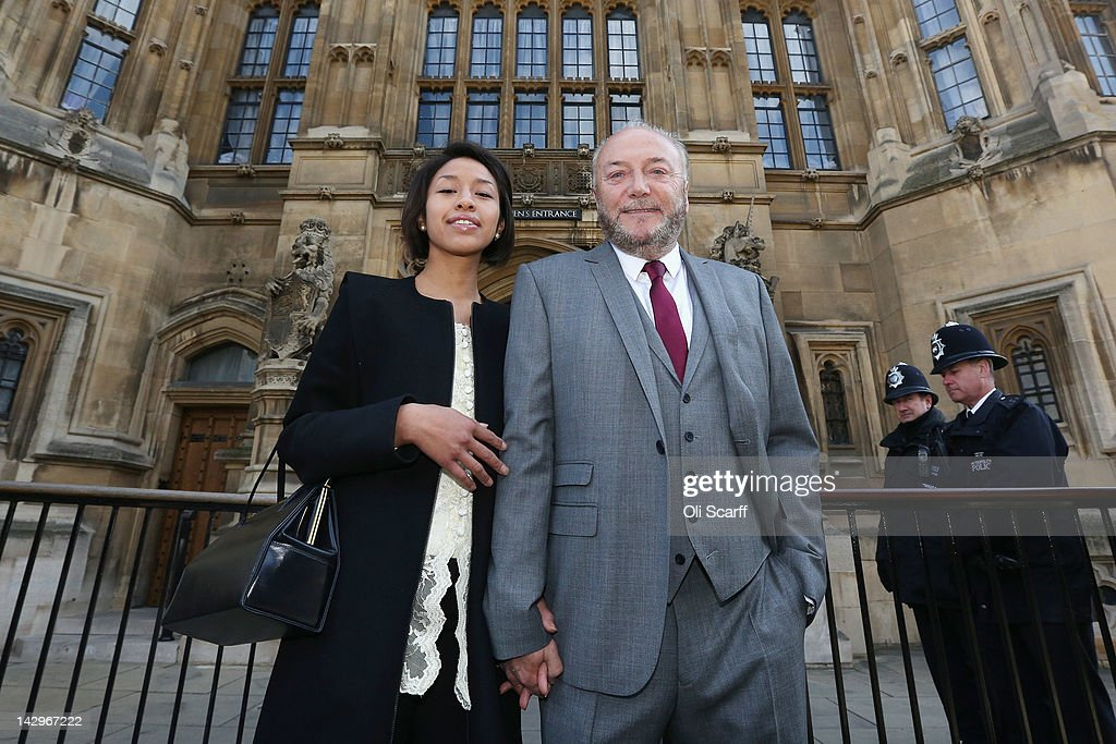 George Galloway poses for a photograph with his wife Putri Gayatri Pertiwi in front of the Houses of Parliament prior to being sworn in as a member of parliament on April 16, 2012 in London, England. Last month Mr Galloway won the Bradford West by-election with a majority of over 10,000 votes from Labour. The shock victory saw a swing towards his Respect party of over 36% from their fifth-place position in the 2010 general election.
