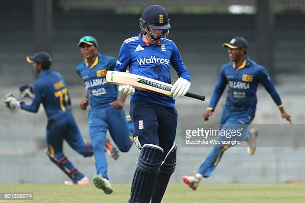 George Garton of England leaves the field after being dismissed as Sri Lanka players celebrate during the Under 19 International Triseries match...