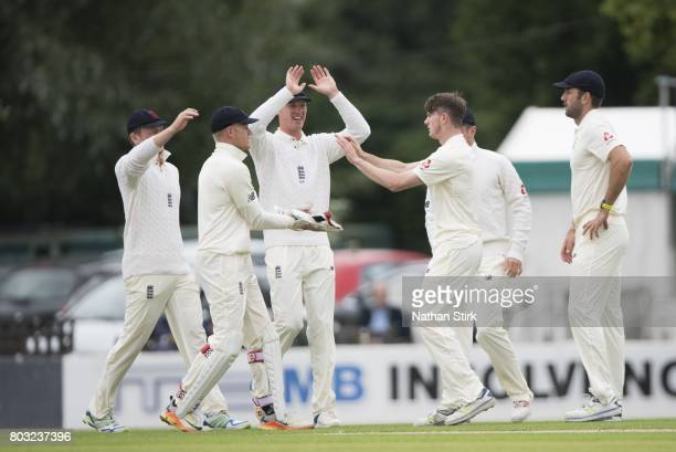 George Garton of England Lions celebrates after getting Dean Elgar of South Africa out during the tour match between England Lions and South Africa A...