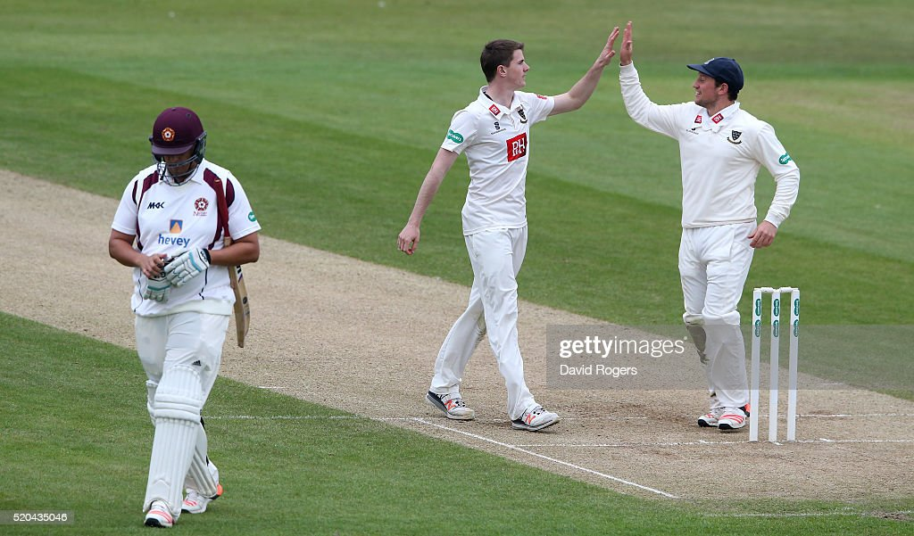 George Garton (C) of Sussex celebrates after taking the wicket of <a gi-track='captionPersonalityLinkClicked' href=/galleries/search?phrase=Rory+Kleinveldt&family=editorial&specificpeople=5434578 ng-click='$event.stopPropagation()'>Rory Kleinveldt</a> during the Specsavers County Championship division two match between Northamptonshire and Sussex at the County Ground on April 11, 2016 in Northampton, England.
