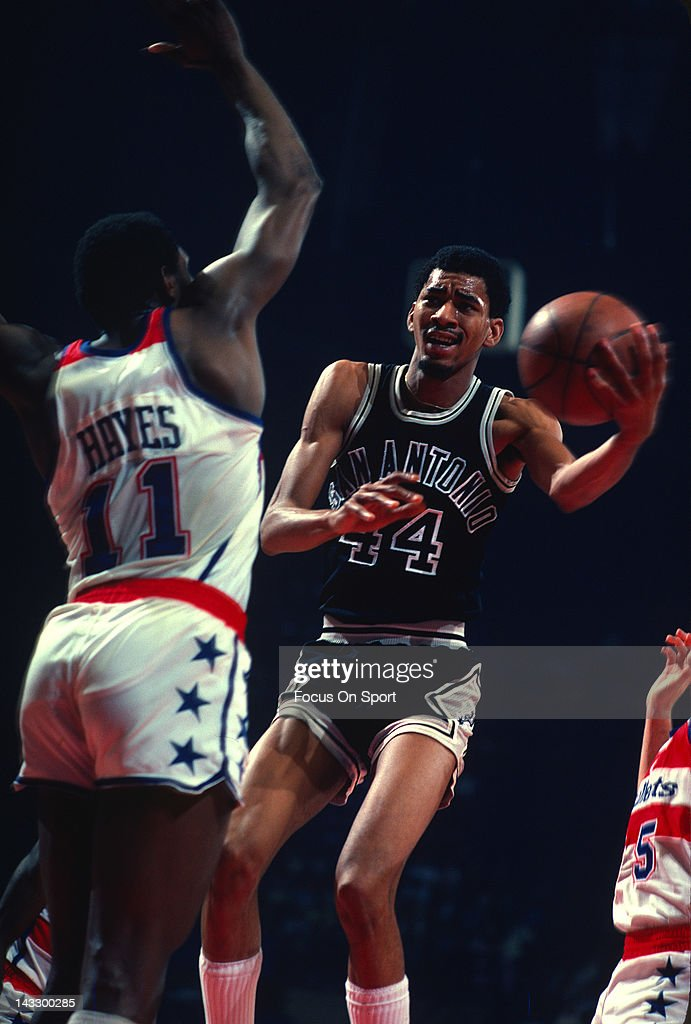 George Gervin of the San Antonio Spurs attempt to lay the ball up over Elvin Hayes of the Washington Bullets during an NBA basketball game circa 1978...