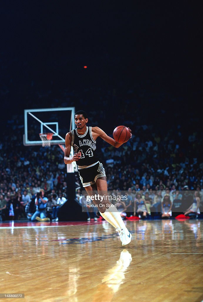 George Gervin of the San Antonio Spurs dribbles the ball up court against the Washington Bullets during an NBA basketball game circa 1978 at the...