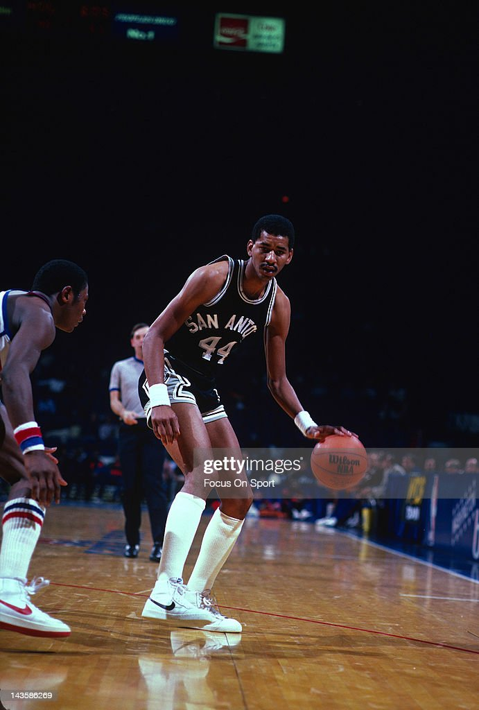 George Gervin of the San Antonio Spurs dribbles the ball up court against the Washington Bullets during an NBA basketball game circa 1982 at the...