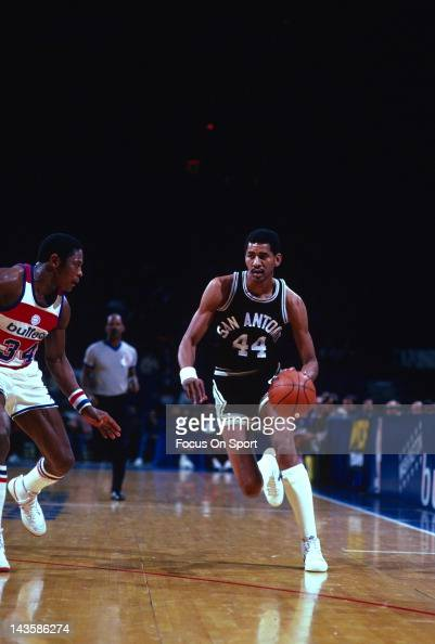 George Gervin of the San Antonio Spurs drives on Billy Ray Bates of the Washington Bullets during an NBA basketball game circa 1982 at the Capital...