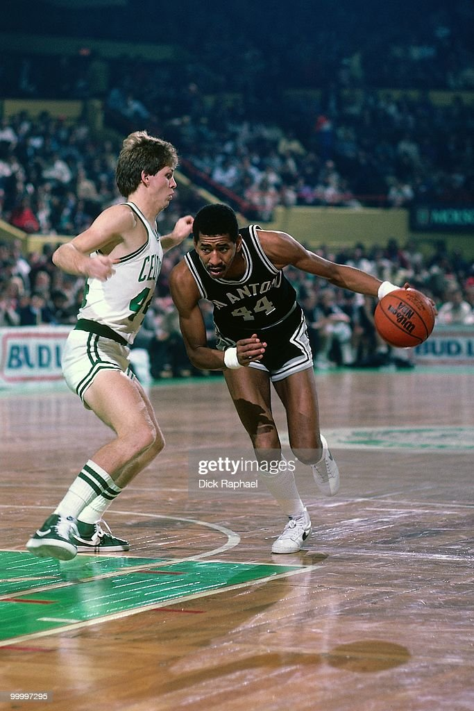 George Gervin of the San Antonio Spurs drives to the basket against Danny Ainge of the Boston Celtics during a game played in 1983 at the Boston...