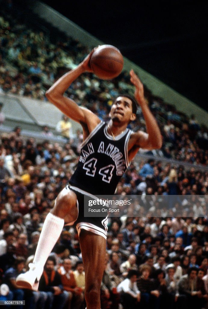 George Gervin of the San Antonio Spurs goes up to slam dunk the ball against the New Jersey Nets during an NBA basketball game circa 1979 at the...