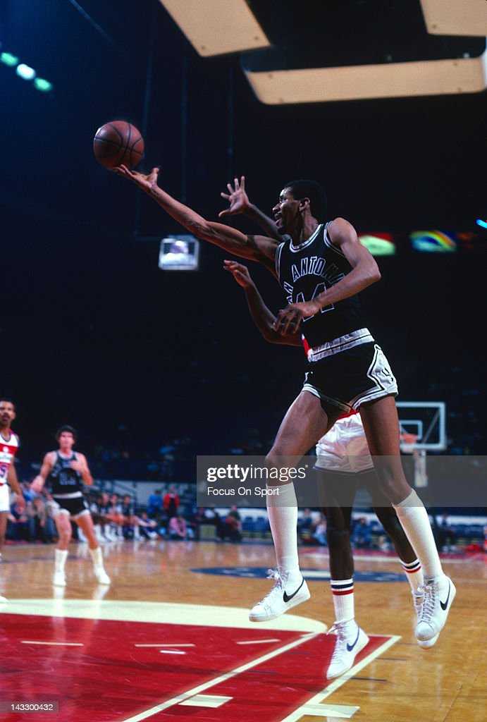 George Gervin of the San Antonio Spurs lays the ball up against the Washington Bullets during an NBA basketball game circa 1982 at the Capital Centre...