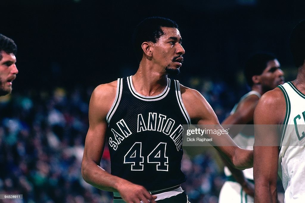 George Gervin of the San Antonio Spurs looks on against the Boston Celtics during a game played in 1982 at the Boston Garden in Boston Massachusetts...