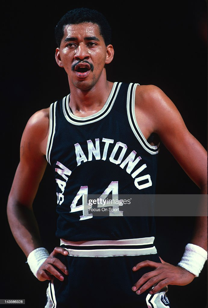 George Gervin of the San Antonio Spurs looks on against the Washington Bullets during an NBA basketball game circa 1984 at the Capital Centre in...