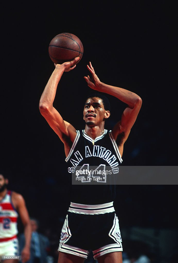 George Gervin of the San Antonio Spurs shoots a freethrow against the Washington Bullets during an NBA basketball game circa 1980 at the Capital...