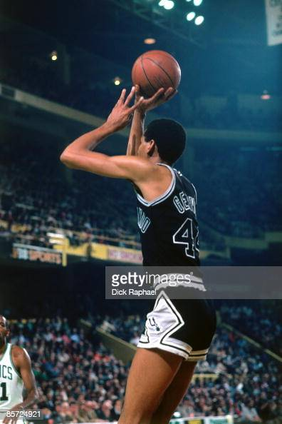 George Gervin of the San Antonio Spurs shoots a jump shot during an NBA game against the Boston Celtics played in 1982 at the Boston Garden in Boston...