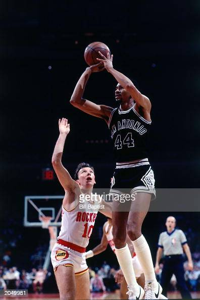 George Gervin of the San Antonio Spurs shoots against the Houston Rockets during a 1984 season NBA game at the Summit in Houston Texas NOTE TO USER...