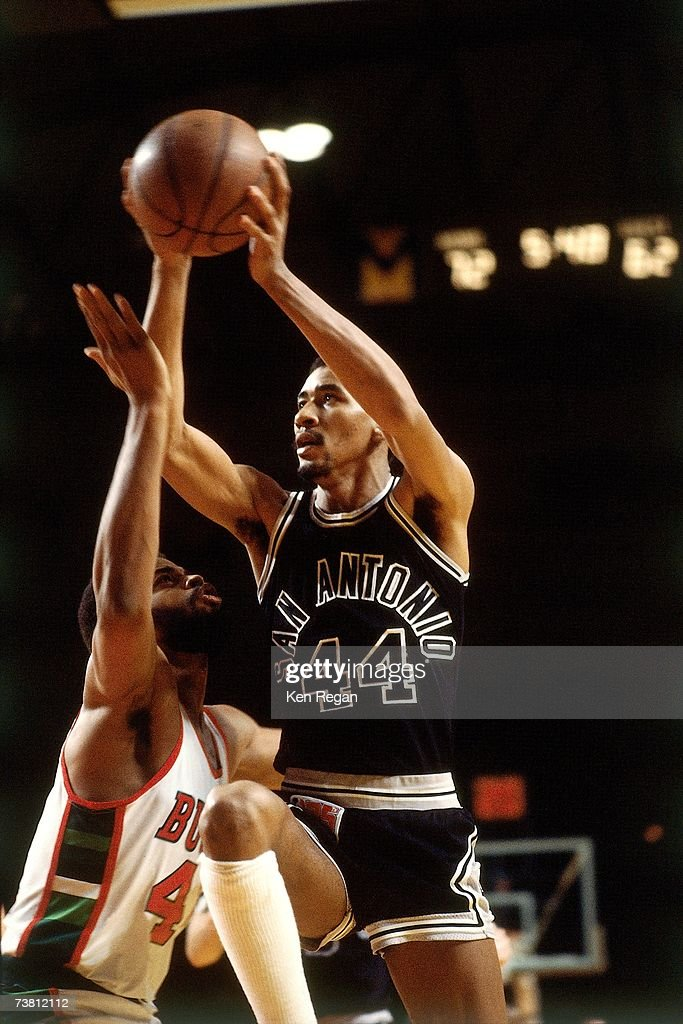 George Gervin of the San Antonio Spurs shoots against the Milwaukee Bucks during a game played in 1980 at the Bradley Center in Milwaukee Wisconsin...