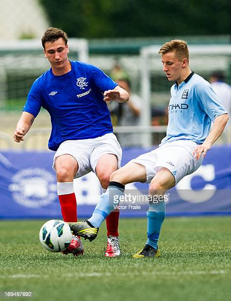 George Glendon of Manchester City and Luca Gasparotto of Rangers fight for the ball on day three of the Hong Kong International Soccer Sevens at Hong...