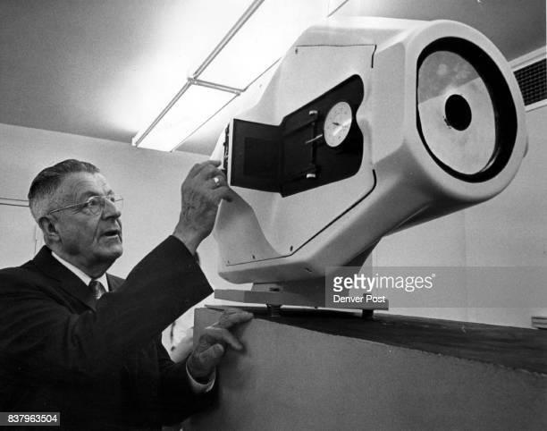 George Goddard Examines Schmidt System Camera at Lowry AFB He is a pioneer in aerial photography and an official of Itek Corp of Boston Mass Credit...