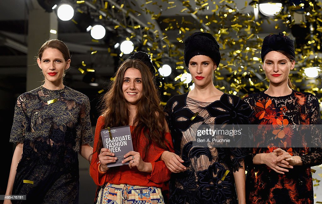 George Gold Award Winner Grace Weller (second left) with models on stage during the Graduate Fashion Week awards show during day 4 of Graduate Fashion Week 2014 at The Old Truman Brewery on June 3, 2014 in London, England.