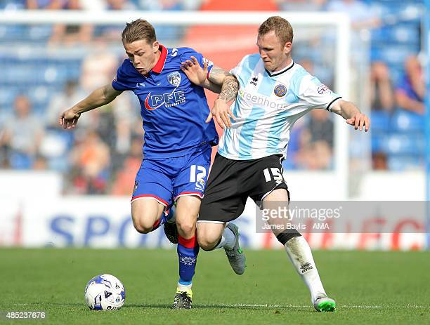 George Green of Oldham Athletic and Mark Ellis of Shrewsbury Town during the Sky Bet League One match between Oldham Athletic and Shrewsbury Town at...