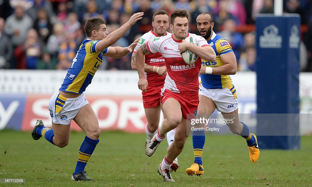 George Griffin of Hull KR gets past Stevie Ward of Leeds during the Super League match between Hull Kingston Rovers and Leeds Rhinos at Craven Park Stadium on April 28, 2013 in Hull, England.